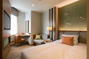 海蘭德水療度假酒店房間的床