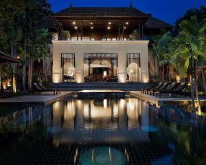 The swimming pool at or near Four Seasons Resort Chiang Mai