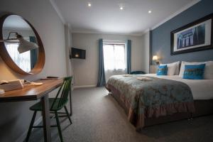 A bed or beds in a room at Highfield Hotel