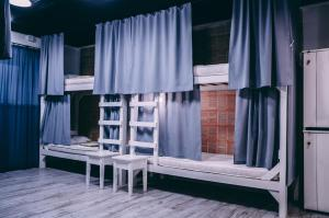A bunk bed or bunk beds in a room at Smart Hostel