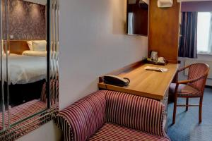 A bed or beds in a room at Best Western Nottingham Derby