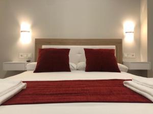 Säng eller sängar i ett rum på Apartamentos Pinar Malaga Centro