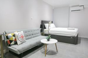 A bed or beds in a room at Deluxe Studio & Suite by Recharge