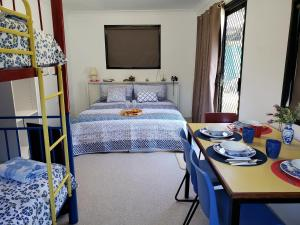 A bed or beds in a room at Christmas Creek Café & Cabins