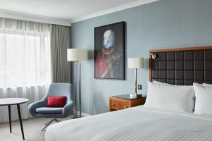 A bed or beds in a room at Portsmouth Marriott Hotel