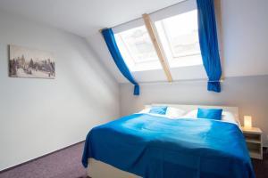 Łóżko lub łóżka w pokoju w obiekcie Adeba Hotel
