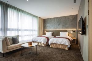 A bed or beds in a room at Green World NanGang