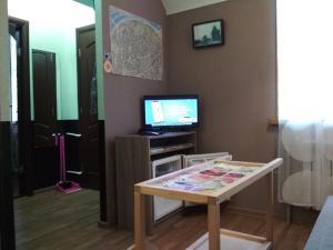 A television and/or entertainment center at Nizhegorodskiye Apartments