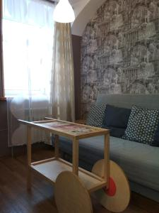 A seating area at Nizhegorodskiye Apartments