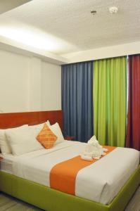 A bed or beds in a room at Villa Israel Eco Park