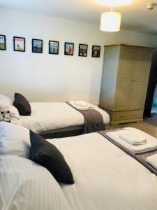 A bed or beds in a room at The Players Golf Club