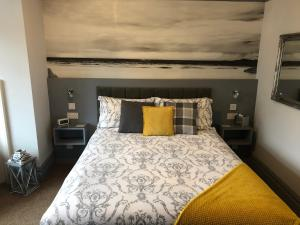 A bed or beds in a room at Swanage Haven Boutique Guest House
