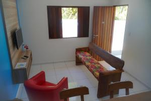 A seating area at Flat Vila Dos Milagres