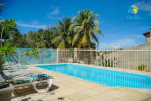 The swimming pool at or close to Flat Vila Dos Milagres