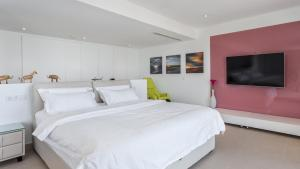 Letto o letti in una camera di The Hype Beach House