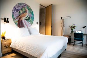 A bed or beds in a room at Hotel Haverkist