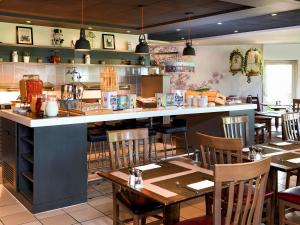 A restaurant or other place to eat at Novotel Milton Keynes