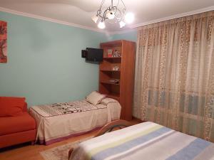 A bed or beds in a room at Despertar con el sonido de los pajaros