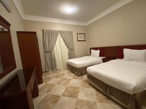 Cama ou camas em um quarto em Aldana Alhezam aldaeri