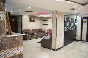 O saguão ou recepção de Rawasi rand Aparthotel