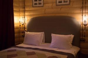 Кровать или кровати в номере Бутик- отель Империал