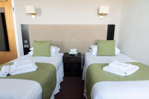 A bed or beds in a room at Kings Arms Hotel - A Bespoke Hotel