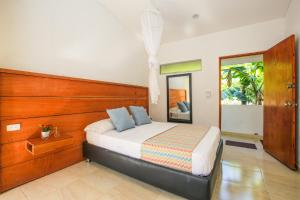 A bed or beds in a room at Manigua Tayrona Hostel
