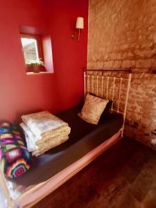 Un ou plusieurs lits dans un hébergement de l'établissement GITE GREEN
