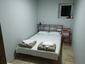 Кровать или кровати в номере Гоcтевой дом Twelve