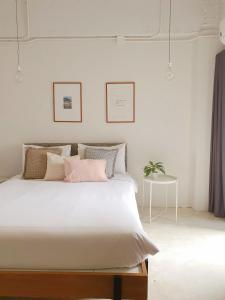 A bed or beds in a room at The51Hometel