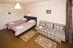 Кровать или кровати в номере База отдыха Байкальская Радуга