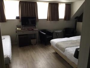 Ein Bett oder Betten in einem Zimmer der Unterkunft Pauls Hotel