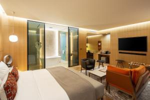 Uma televisão e/ou sistema de entretenimento em Hotel28 Myeongdong
