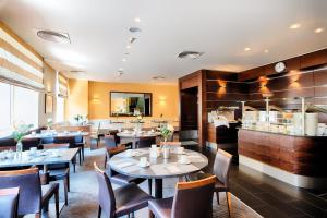 A restaurant or other place to eat at ACHAT Hotel Wiesbaden City
