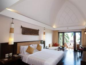 A bed or beds in a room at Rawi Warin Resort And Spa
