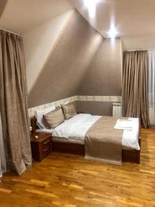 Cama ou camas em um quarto em Nizami Street 41D