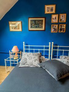 A bed or beds in a room at la ferme des belles gourmandes