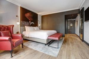 A bed or beds in a room at Radisson RED London Heathrow