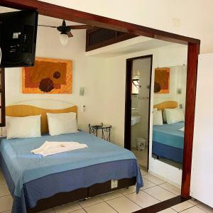 A bed or beds in a room at Feiticeira Praia Hotel