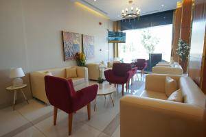 Uma área de estar em Kayan Al Taif Hotel