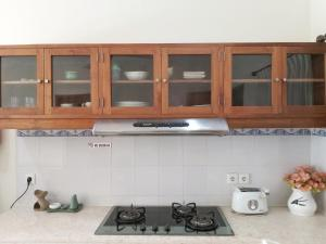 A kitchen or kitchenette at Bali Paradise Apartments