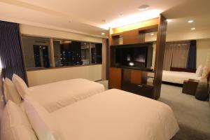 A bed or beds in a room at Richmond Hotel Premier Tokyo Oshiage
