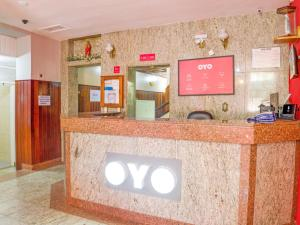 The lobby or reception area at OYO Hotel Lindoia