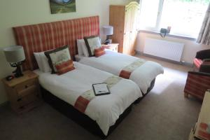 A bed or beds in a room at Monamore Guest House