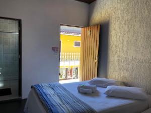 A bed or beds in a room at Pousada Príncipe dos Mares