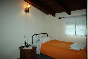 Ένα ή περισσότερα κρεβάτια σε δωμάτιο στο Xenonas 1963