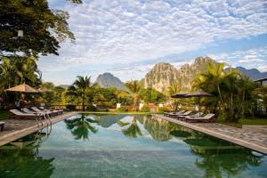 The swimming pool at or near Riverside Boutique Resort, Vang Vieng