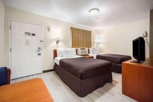 A television and/or entertainment center at Suburban Extended Stay Hotel Biloxi North Area