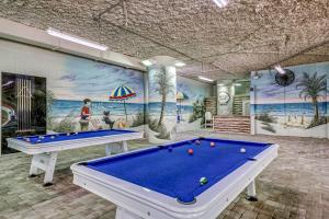 A pool table at Dunes Village