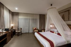 A bed or beds in a room at Eskala Hotels and Resorts